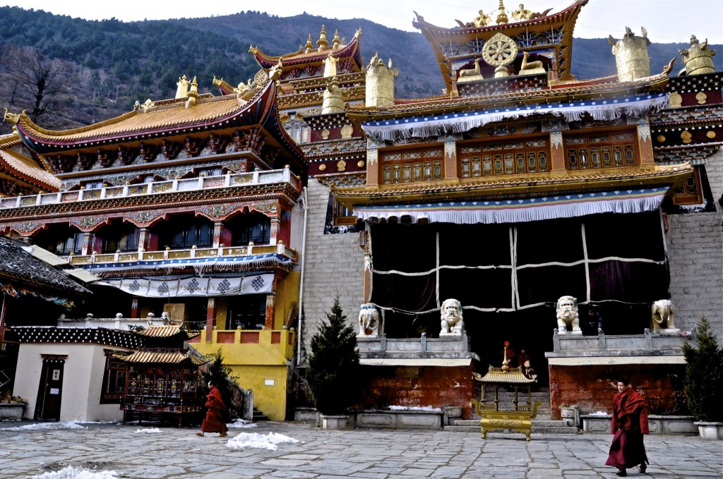 Monks outside a monastery in Kangding, Overland from Chengdu to Shangri La