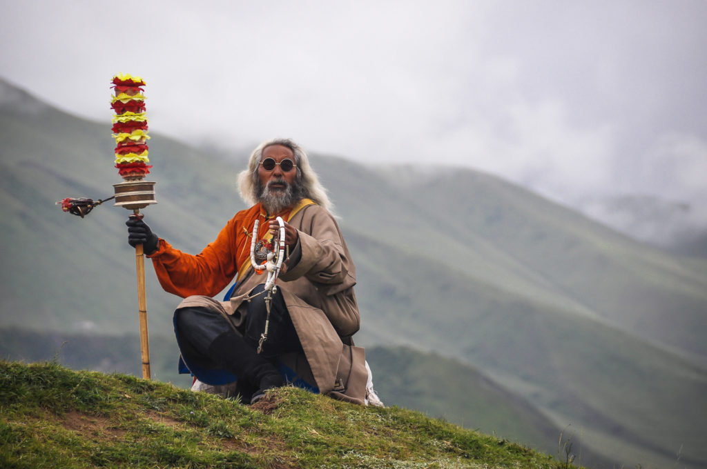 A nomadic man with his prayer wheel in eastern Tibet