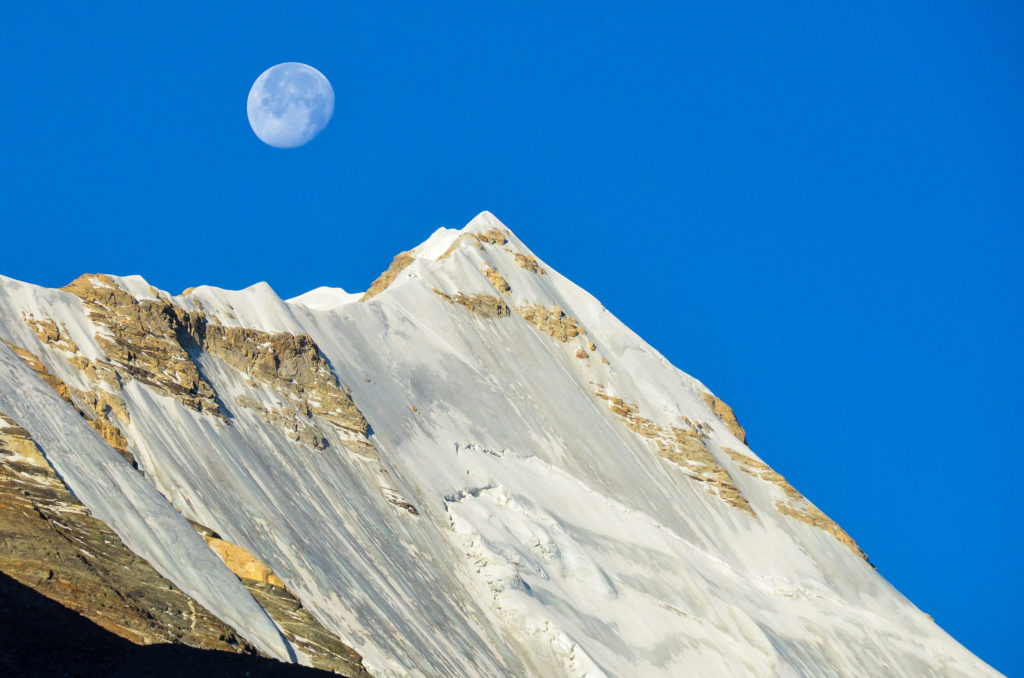 The moon above the Himalaya in Tibet